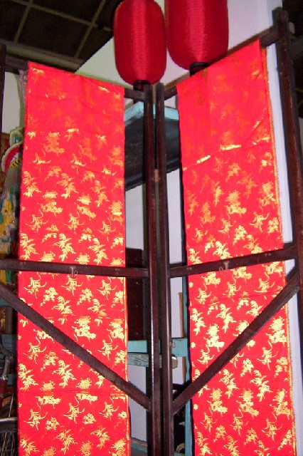 Screen - wooden screen with Chinese fabric panels, red side