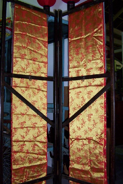 Screen - wooden screen with Chinese fabric panels, red and yllow.