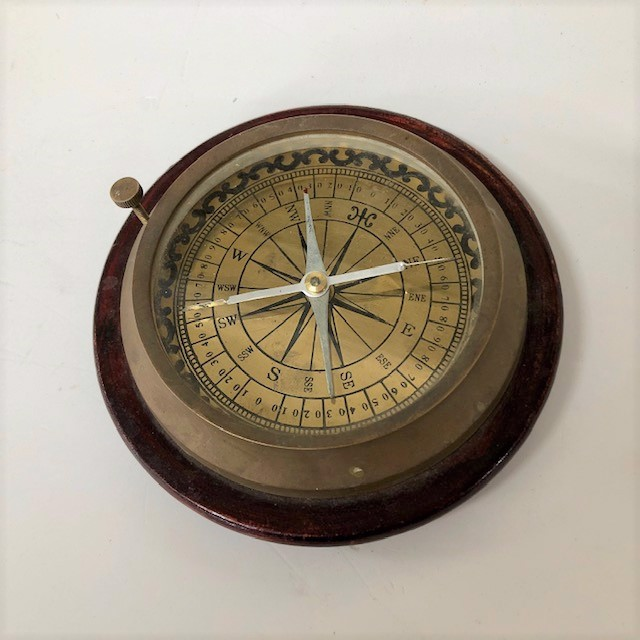 COM0001 COMPASS, Brass on Timber Base w Legs $8.75