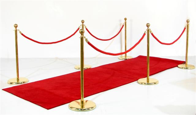 Red carpet entrance with barrier poles
