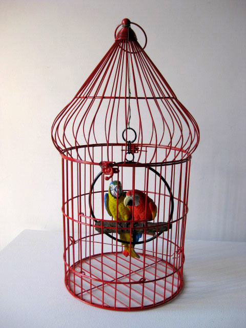 Red wire birdcage with parrots