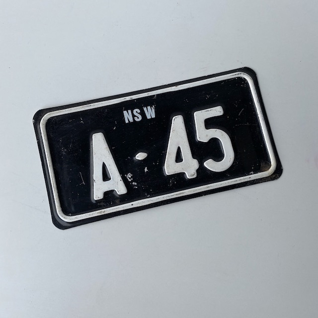 NUM0012 NUMBER PLATE, NSW - Black White Small A45 (Single) $10