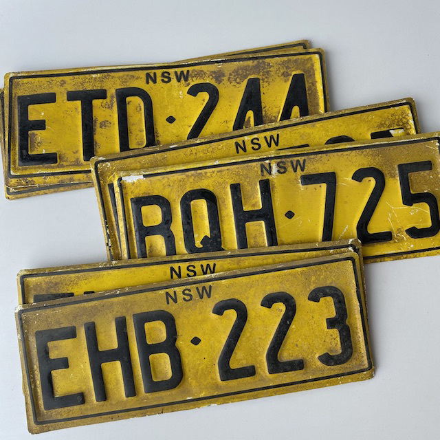 NUM0023 NUMBER PLATE, NSW Yellow Black Aged (Pair) $20
