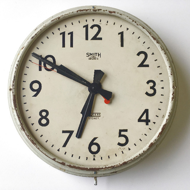CLO0080 CLOCK, Wall Mount - 1940s Cream Metal Smiths $22.50