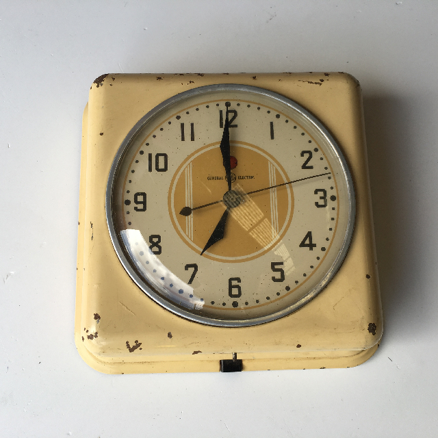 CLO0084 CLOCK, Wall Mount - 1950s Yellow GE $18.75