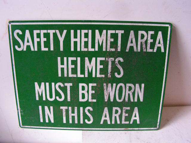 SIG0315 SIGN, Construction - Green Safety Helmets $12.50